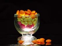 Comprimidos de incandescência no vidro Imagem de Stock Royalty Free