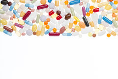 Comprimidos diferentes com espaço branco da cópia foto de stock