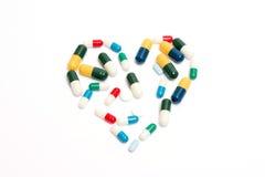 Comprimidos do coração fotos de stock