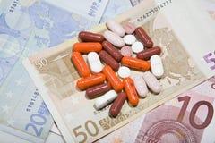 Comprimidos do und dos euro Fotografia de Stock