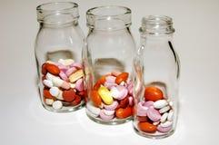 Comprimidos e comprimidos Foto de Stock