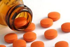 Comprimidos e frasco Fotografia de Stock