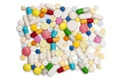 Comprimidos e montão das cápsulas Fotografia de Stock