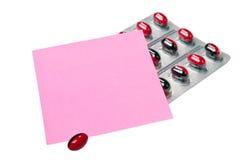 Comprimidos e papel de nota Foto de Stock