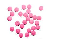 Comprimidos médicos cor-de-rosa no fundo branco Imagens de Stock