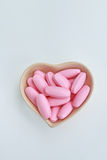 Comprimidos ovais cor-de-rosa na forma do copo de heart2 Foto de Stock Royalty Free