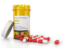 Comprimidos que derramam fora do frasco de comprimido Foto de Stock