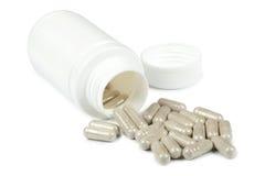 Comprimidos que derramam um frasco branco Foto de Stock