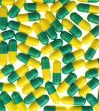 Comprimidos verdes e amarelos Fotografia de Stock