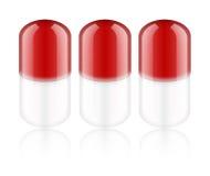 Comprimidos vermelhos Fotografia de Stock