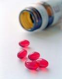 Comprimidos vermelhos Fotografia de Stock Royalty Free