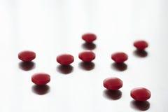 Comprimidos vermelhos Foto de Stock