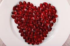 Comprimidos vermelhos do coração Imagens de Stock Royalty Free