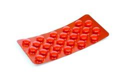 Comprimidos vermelhos em uma bolha Foto de Stock Royalty Free