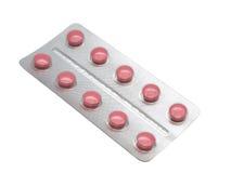 Comprimidos vermelhos isolados Fotos de Stock