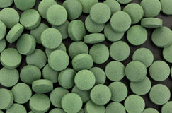 Comprimés verts de supplément de fer Images stock