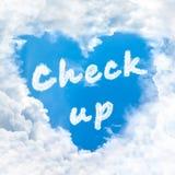 Compruebe encima de la naturaleza de la palabra en el cielo azul Foto de archivo libre de regalías