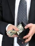 comptant des dollars nous Photos libres de droits