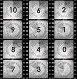 Compte à rebours grunge de film dans la couleur foncée Photos stock