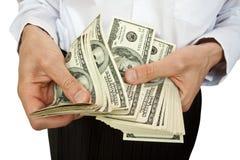Compte d'argent dans des mains images stock