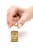 Compte des pièces de monnaie Images libres de droits