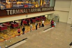 Compteurs d'immigration d'arrivée d'aéroport de Singapour Changi Images libres de droits