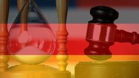Compuesto de Digitaces de la bandera y del reloj de arena de Alemania almacen de video