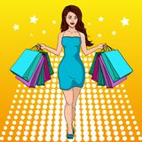 Girl with shopping. I bought a lot of clothes. Gift bags. Fashion illustration. Pop art. Compulsive buying disorder, or oniomania. Girl with shopping. I bought a Stock Images