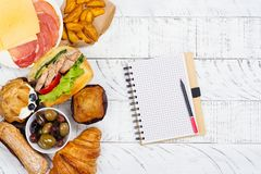 Compulsive eating or eating disorder concept. Copy space. Compulsive eating or eating disorder concept. Notepad and pencil, space for text. Copy space Stock Photo