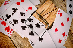Compulsive gambling. Cards inside a mousetrap, a gambling addiction concept Royalty Free Stock Image