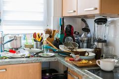 Compulsive Hoarding Syndrom - messy kitchen. With pile of dirty dishes royalty free stock images