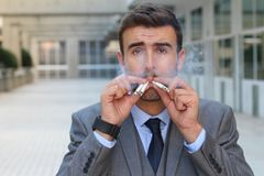 Compulsive man with an intense substance abuse.  Stock Photo