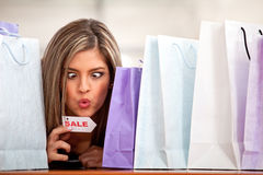 Compulsive shopping woman Royalty Free Stock Photography