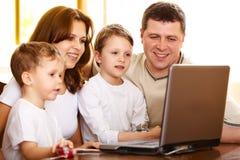 Computador da família Fotografia de Stock Royalty Free