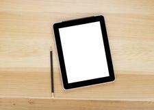 Computador da tabuleta da tela de toque com tela vazia e lápis foto de stock