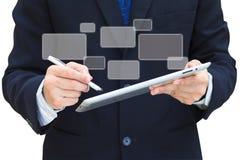Computador da tabuleta da tela de toque da preensão da mão do negócio foto de stock