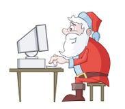 Computador do uso de Papai Noel Foto de Stock