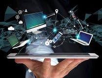 Computador e dispositivos indicados em uma relação futurista com dentro Fotografia de Stock Royalty Free