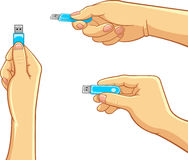 Computador - mão que guarda uma movimentação do flash de USB Imagem de Stock Royalty Free