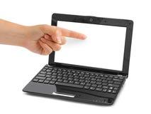 Computador portátil e mão apontar imagem de stock