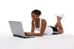 Computadora portátil adolescente Foto de archivo