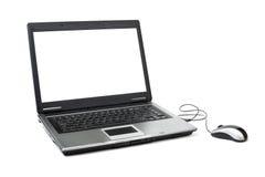 Computadora portátil con el ratón Fotografía de archivo libre de regalías
