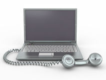 Computadora portátil con el receptor pasado de moda del teléfono Imágenes de archivo libres de regalías