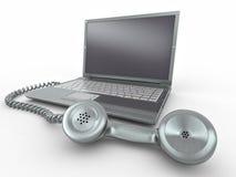 Computadora portátil con el receptor pasado de moda del teléfono Imagen de archivo libre de regalías