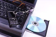 Computadora portátil con el teléfono Fotografía de archivo libre de regalías