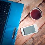 Computadora portátil con el teléfono móvil Imágenes de archivo libres de regalías
