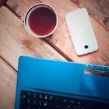 Computadora portátil con el teléfono móvil Imagen de archivo