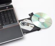 Computadora portátil con la bandeja CD abierta Fotos de archivo libres de regalías