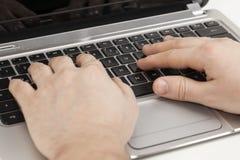 computadora portátil con la mano 1 aislada Imagen de archivo libre de regalías