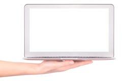 Computadora portátil con la mano de la mujer aislada Imagen de archivo